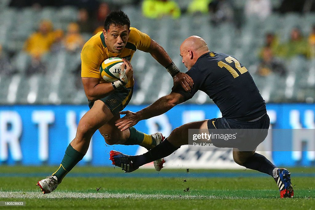 Christian Leali'ifano of the Wallabies evades a tackle by <a gi-track='captionPersonalityLinkClicked' href=/galleries/search?phrase=Felipe+Contepomi&family=editorial&specificpeople=562276 ng-click='$event.stopPropagation()'>Felipe Contepomi</a> of Argentina during The Rugby Championship match between the Australian Wallabies and Argentina at Patersons Stadium on September 14, 2013 in Perth, Australia.