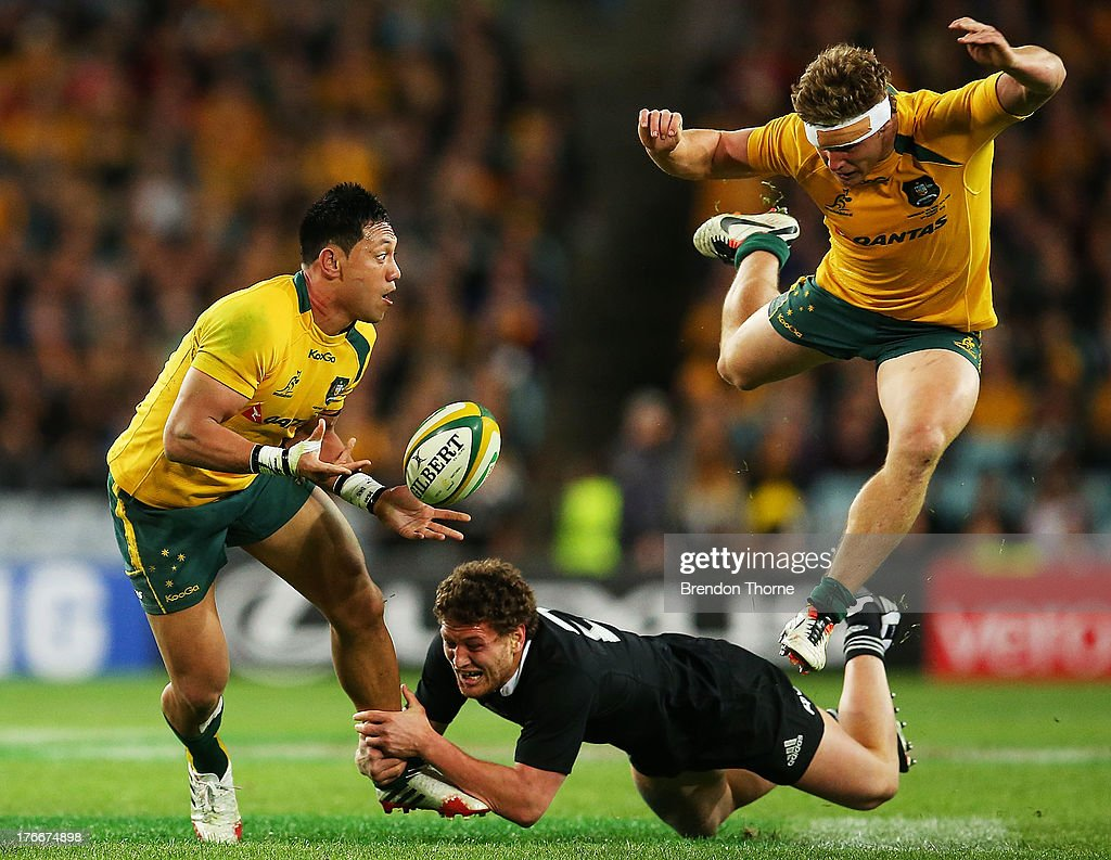 Christian Lealiifano of the Wallabies offloads the ball to team mate Michael Hooper during The Rugby Championship Bledisloe Cup match between the...