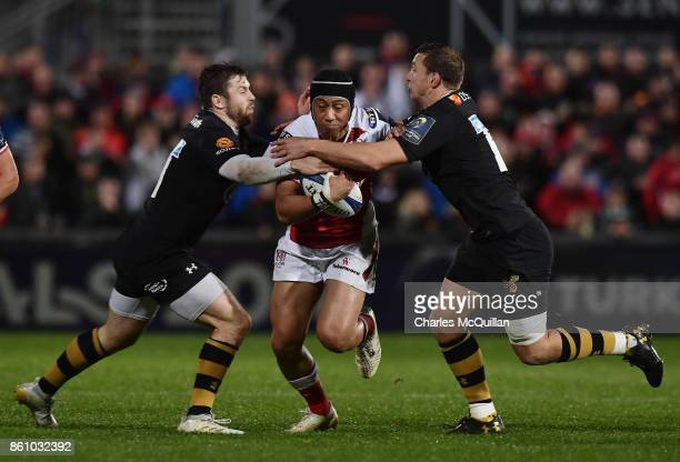 Christian Lealiifano of Ulster is tackled by Brendan Macken and Elliot Daly of Wasps during the European Rugby Champions Cup match between Ulster...