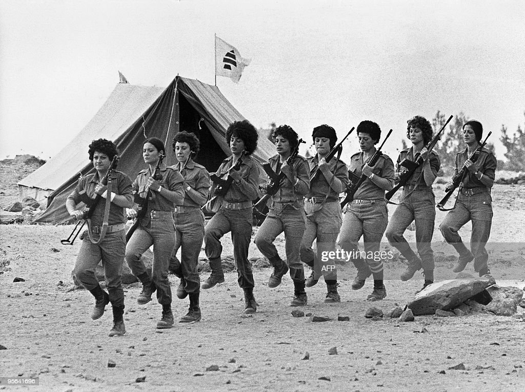 Christian Lebanese young women, members of Kataeb Phalangist party show their skill in handling arms while they train in a village between Christian-controlled eastern port of Jounieh and the Christian village of Zahle in the west Lebanon. The Lebanese civil war erupted in April 1975.
