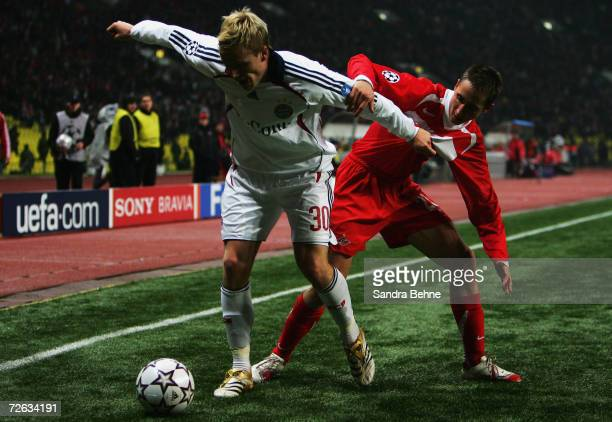 Christian Lell of Bayern Munich holds the ball up against Vladimir Bystrov of Spartak Moscow during the UEFA Champions League group B match between...
