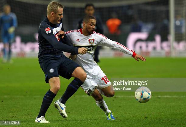 Christian Lell of Berlin and Sydney Sam of Leverkusen battle for the ball during the Bundesliga match between Hertha BSC Berlin and Bayer 04...