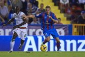 Christian Lell of Levante competes for the ball with Pereira of Granada during the La Liga match between Levante UD and Granada CF at Ciutat de...