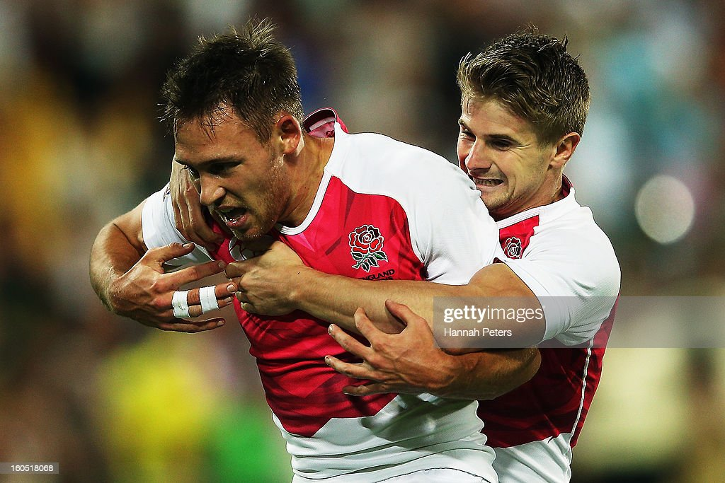 Christian Lewis-Pratt celebrates with Sam Edgerley of England celebrates after scoring a try during the grand final between England and Kenya during the 2013 Wellington Sevens at Westpac Stadium on February 2, 2013 in Wellington, New Zealand.