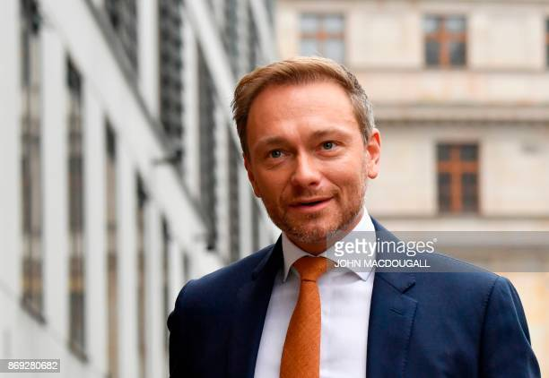 Christian Lindner chairman of Germany's free democratic FDP party arrives for exploratory talks with members of possible coalition parties to form a...