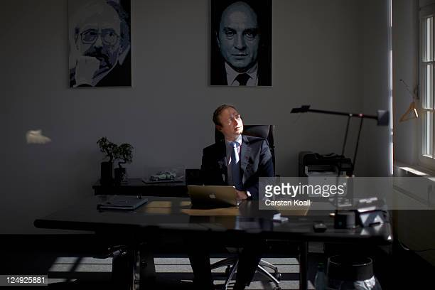 Christian Lindner General Secretary of the German Free Democrats political party sits on his desk looks to the window as he is working with a laptop...