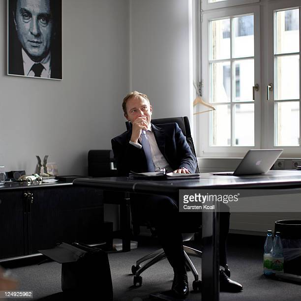 Christian Lindner General Secretary of the German Free Democrats political party sits on his desk working with a laptop computer macbook air in his...
