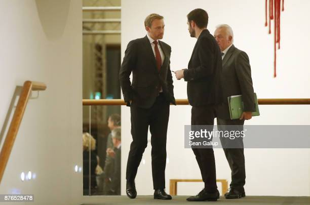 Christian Lindner head of the Free Democratic Party and accompanied by FDP member Wolfgang Kubicki prepares to give a statement to the media to...