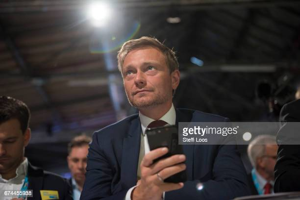 Christian Lindner head of the German Free Democratic Party holds a mobile phone at the Federal Congress of FDP Political Party on April 28 2017 in...