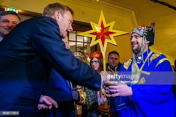Christian Lindner head of the German Free Democratic Party is seen with carollers dressed as the Three Kings during the traditional Epiphany meeting...