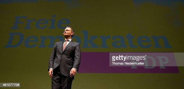 Christian Lindner head of the German Free Democratic Party talks in front of the new logo of FDP during the traditional Epiphany meeting of the...