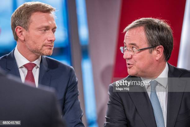 Christian Lindner lead candidate of the German Free Democrats and Armin Laschet of the German Christian Democrats look at each other during a...