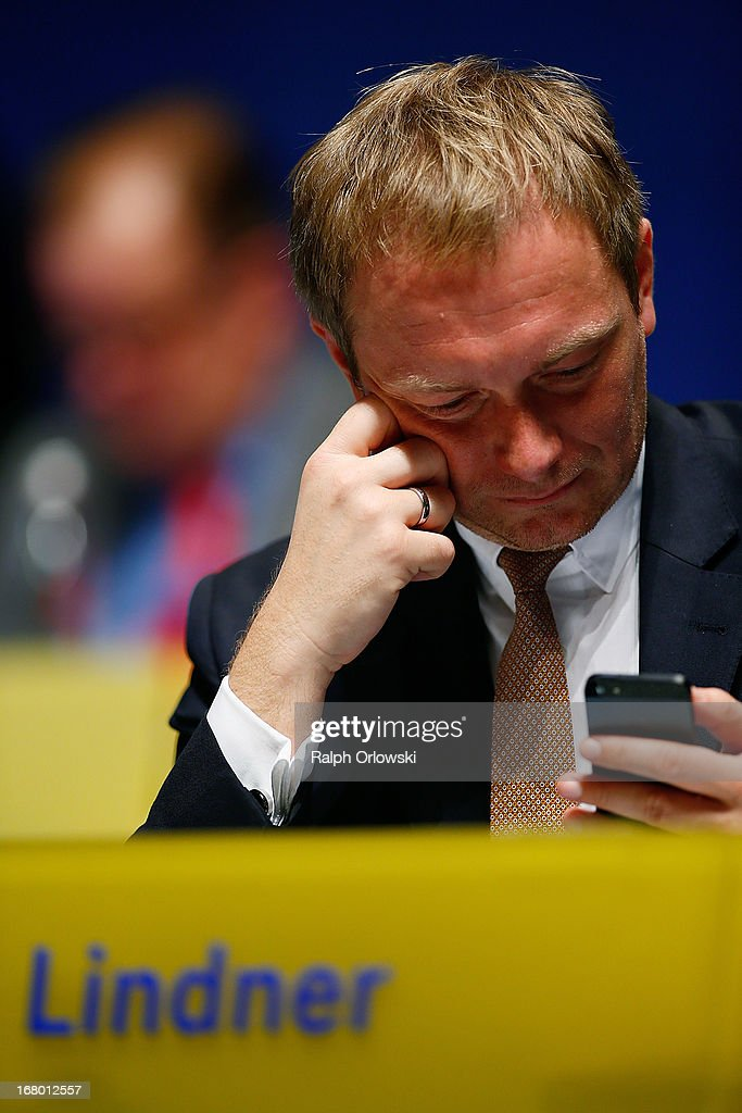 Christian Lindner, member of the German Free Democrats (FDP) political party, checks his cell phone at the FDP federal congress (Bundesparteitag) on May 4, 2013 in Nuremburg, Germany. The FDP is the junior partner in the current German government coalition, though its popularity has faltered in recent years and the party is in danger of not receiving the required minimum of 5% of votes to retain seats in the Bundestag in federal elections scheduled for September.