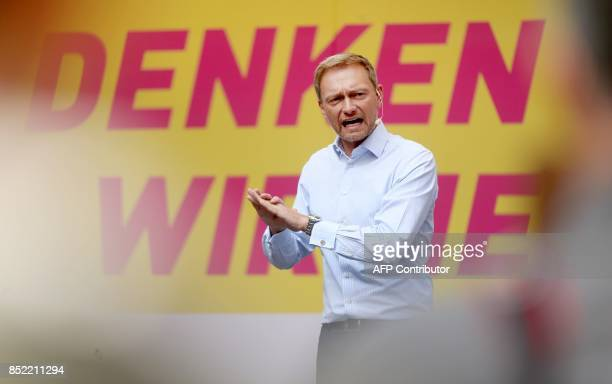 Christian Lindner top candidate of Germany's free democratic FDP party gestures as he campaigns in Duesseldorf western Germany on September 23 one...