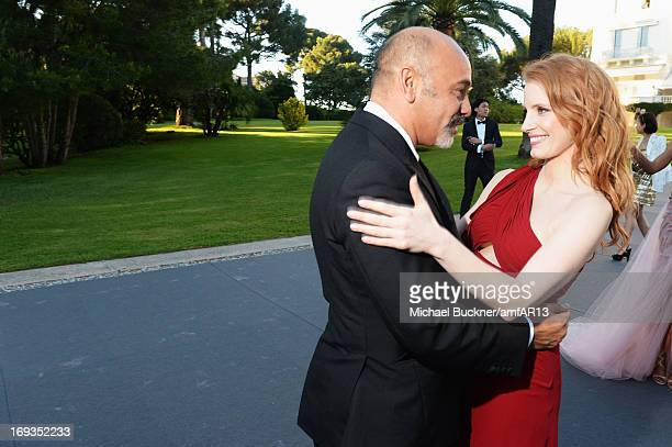 Christian Louboutin and Jessica Chastain attend amfAR's 20th Annual Cinema Against AIDS during The 66th Annual Cannes Film Festival at Hotel du...