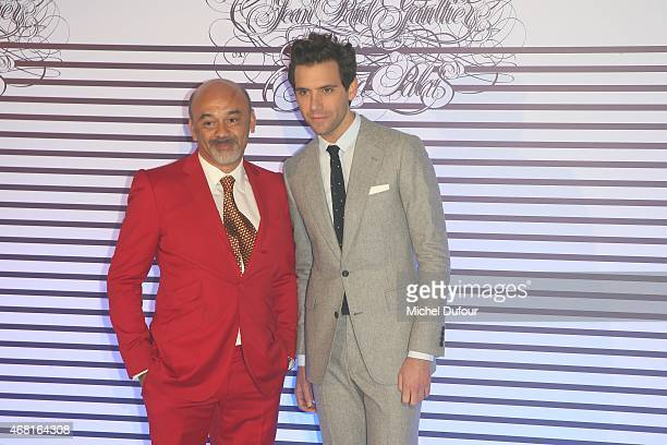 Christian Louboutin and Mika attends the Jean Paul Gaultier Exhibition photocall at Grand Palais on March 30 2015 in Paris France