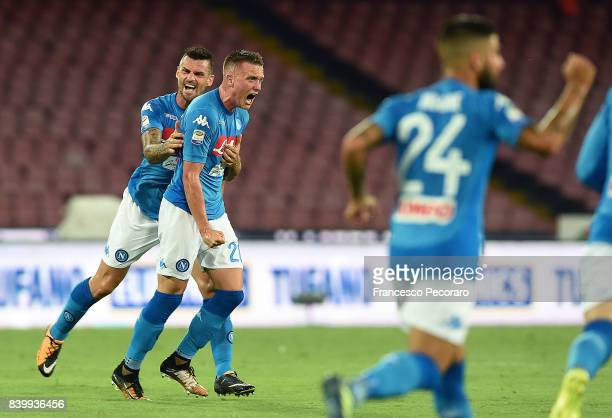 Christian Maggio and Piotr Zielinski of SSC Napoli celebrate the 11 goal scored by Piotr Zielinski during the Serie A match between SSC Napoli and...