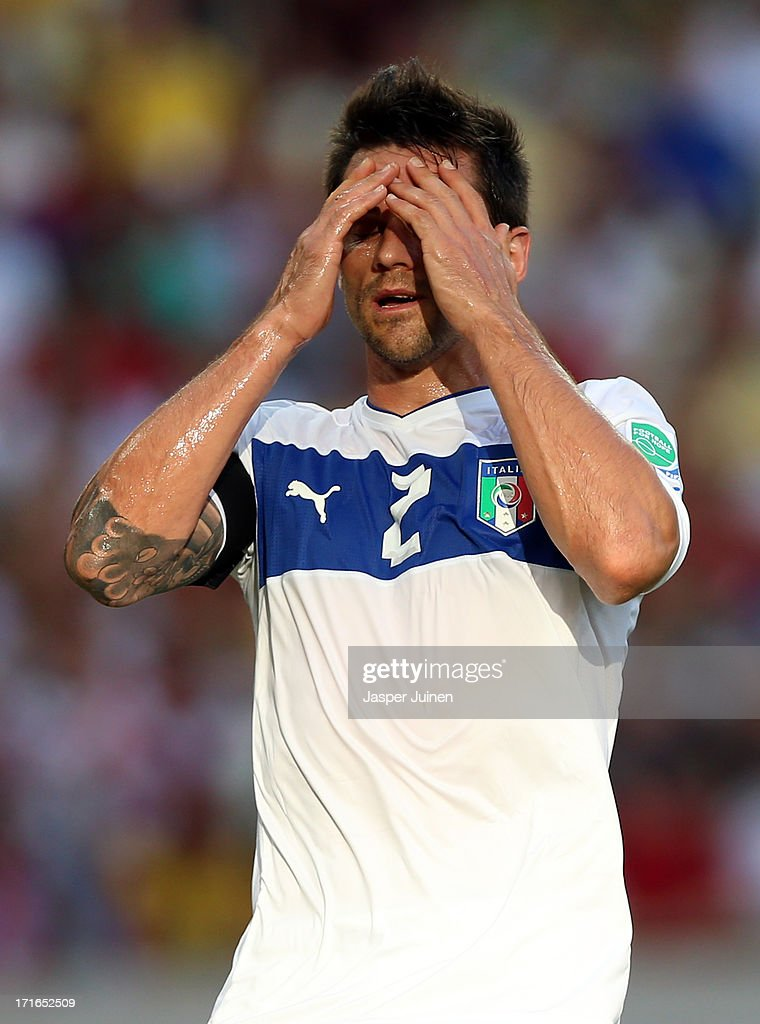 <a gi-track='captionPersonalityLinkClicked' href=/galleries/search?phrase=Christian+Maggio&family=editorial&specificpeople=2131601 ng-click='$event.stopPropagation()'>Christian Maggio</a> of Italy reacts during the FIFA Confederations Cup Brazil 2013 Semi Final match between Spain and Italy at Castelao on June 27, 2013 in Fortaleza, Brazil.