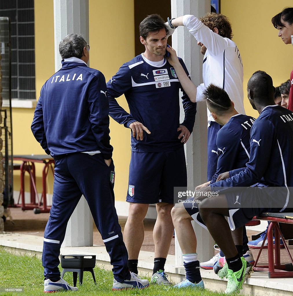 <a gi-track='captionPersonalityLinkClicked' href=/galleries/search?phrase=Christian+Maggio&family=editorial&specificpeople=2131601 ng-click='$event.stopPropagation()'>Christian Maggio</a> of Italy receives attention during a training session at Coverciano on March 24, 2013 in Florence, Italy.