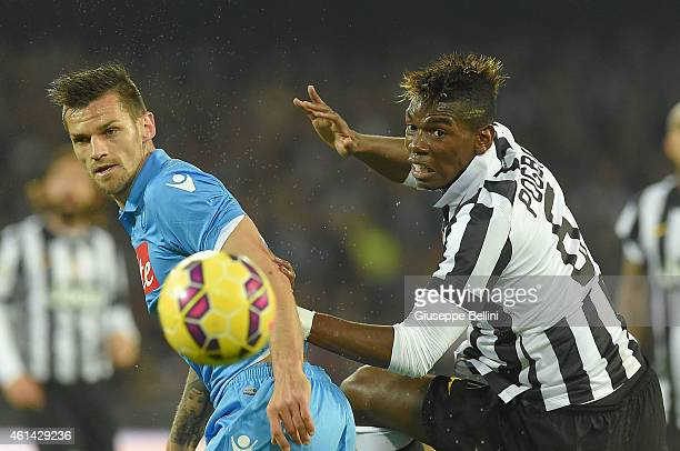 Christian Maggio of Napoli and Paul Pogba of Juventus in action during the Serie A match between SSC Napoli and Juventus FC at Stadio San Paolo on...