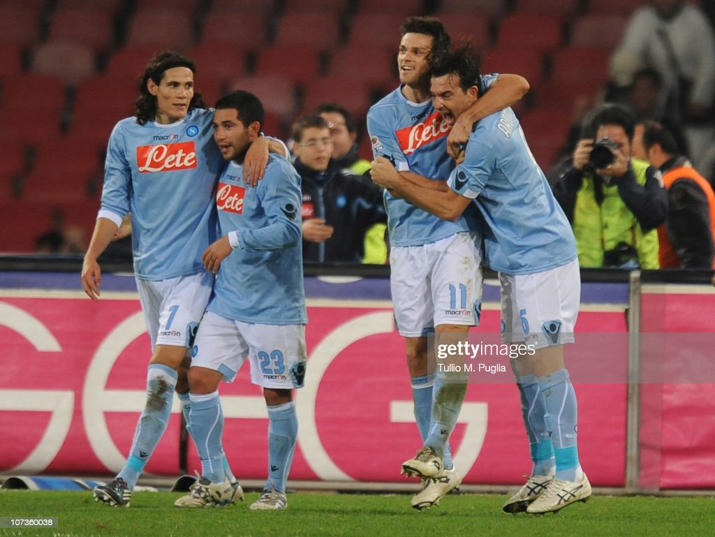 <a gi-track='captionPersonalityLinkClicked' href=/galleries/search?phrase=Christian+Maggio&family=editorial&specificpeople=2131601 ng-click='$event.stopPropagation()'>Christian Maggio</a> (2nd-R) of Napoli celebrates with his team mates after scoring the opening goal during the Serie A match between Napoli and Palermo at Stadio San Paolo on December 6, 2010 in Naples, Italy.