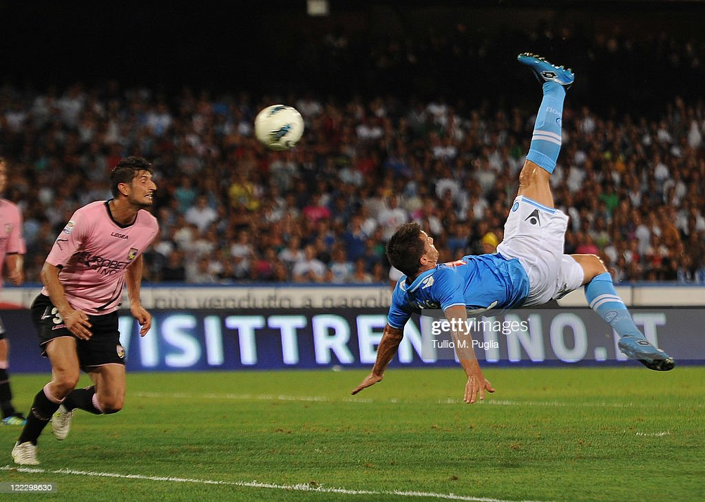 <a gi-track='captionPersonalityLinkClicked' href=/galleries/search?phrase=Christian+Maggio&family=editorial&specificpeople=2131601 ng-click='$event.stopPropagation()'>Christian Maggio</a> of Napoli scores his team's second goal during the pre season friendly match between SSC Napoli and US Citta di Palermo at Stadio San Paolo on August 27, 2011 in Naples, Italy.