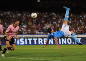 Christian Maggio of Napoli scores his team's second goal during the pre season friendly match between SSC Napoli and US Citta di Palermo at Stadio...