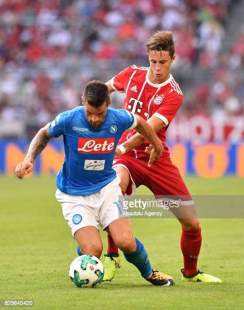 Christian Maggio of SSC Napoli in action against Marco Friedl of Bayern Munich during the Audi Cup soccer match between FC Bayern Munich and SSC...