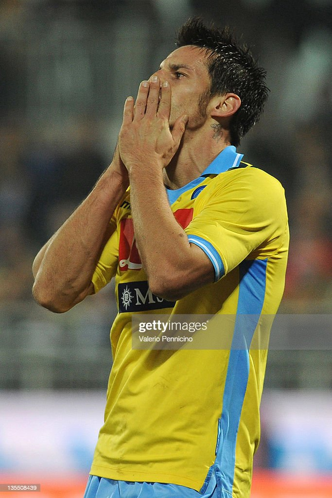 <a gi-track='captionPersonalityLinkClicked' href=/galleries/search?phrase=Christian+Maggio&family=editorial&specificpeople=2131601 ng-click='$event.stopPropagation()'>Christian Maggio</a> of SSC Napoli reacts during the Serie A match between Novara Calcio and SSC Napoli at Silvio Piola Stadium on December 11, 2011 in Novara, Italy.