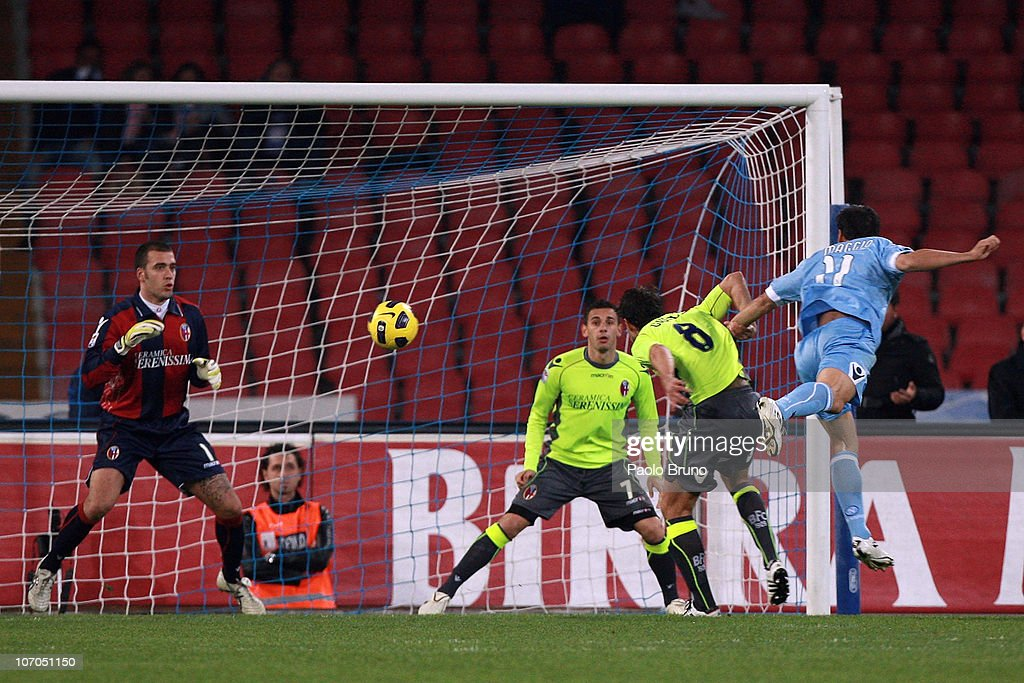 <a gi-track='captionPersonalityLinkClicked' href=/galleries/search?phrase=Christian+Maggio&family=editorial&specificpeople=2131601 ng-click='$event.stopPropagation()'>Christian Maggio</a> (R) of SSC Napoli scores the opening goal during the Serie A match between SSC Napoli and Bologna FC at Stadio San Paolo on November 21, 2010 in Naples, Italy.