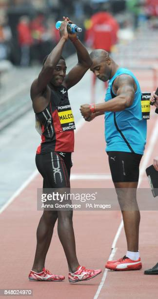 Christian Malcolm celebrates after beating Mark Lewis Francis to win the Men's 100m event during the Great CityGames on Deansgate Manchester