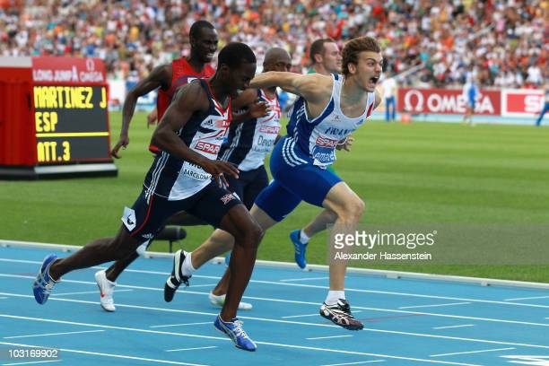 Christian Malcolm of Great Britain and Christophe Lemaitre of France compete in the Mens 200m Final during day four of the 20th European Athletics...