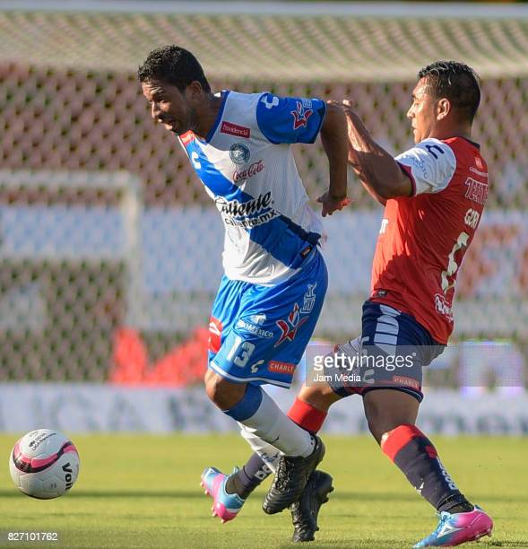Christian Marrugo of Puebla fights for the ball with Christian Valdez of Veracruz during the 3rd round match between Veracruz and Puebla as part of...
