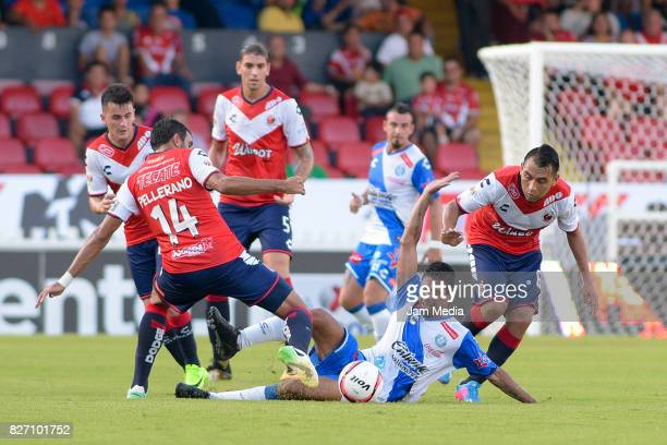 Christian Marrugo of Puebla fights for the ball with Cristian Pellerano of Veracruz during the 3rd round match between Veracruz and Puebla as part of...