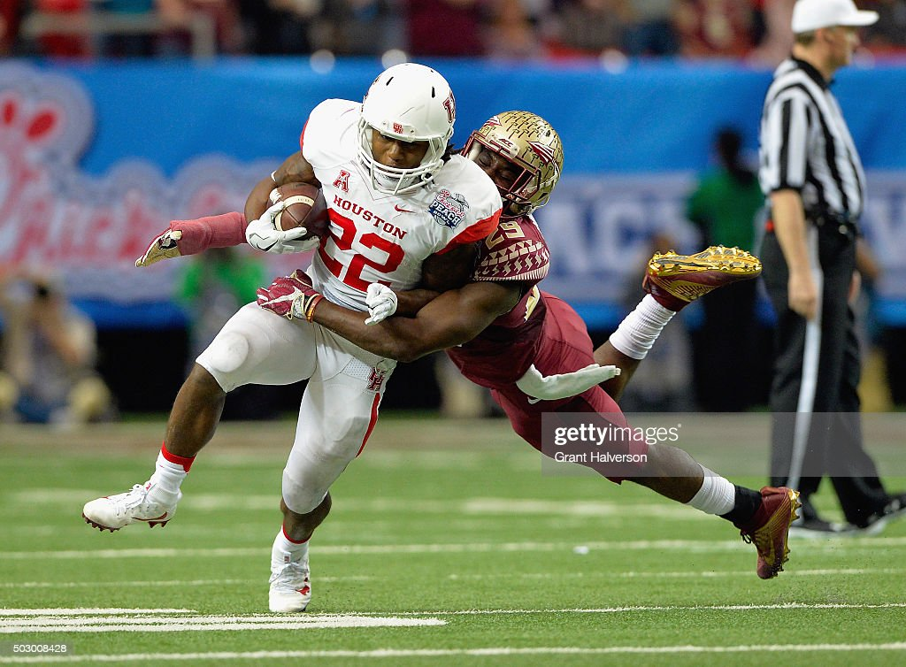 Christian Martinez of the Houston Cougars is tackled by Terrance Smith of the Florida State Seminoles in the first quarter during the ChickfilA Peach...