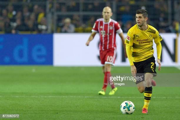 Christian Mate Pulisic of Dortmund controls the ball during the German Bundesliga match between Borussia Dortmund v Bayern Munchen at the Signal...