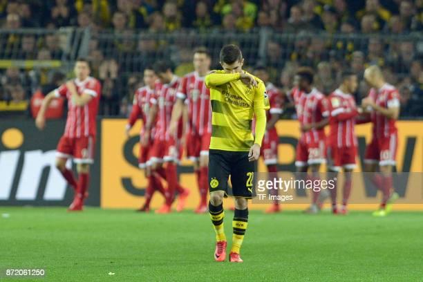 Christian Mate Pulisic of Dortmund looks dejected during the German Bundesliga match between Borussia Dortmund v Bayern Munchen at the Signal Iduna...