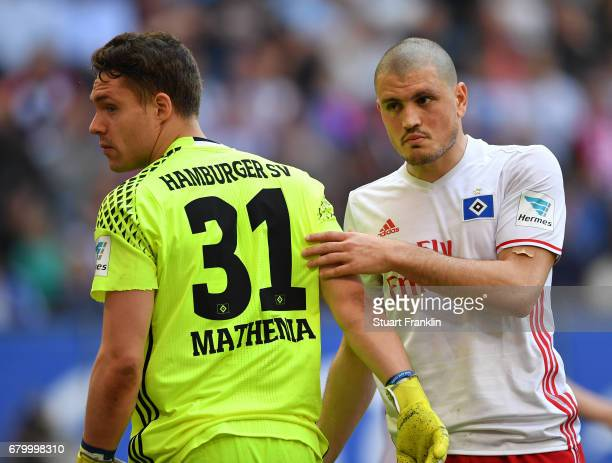 Christian Mathenia and Kyriakos Papadopoulos of Hamburg look dejected during the Bundesliga match between Hamburger SV and 1 FSV Mainz 05 at...