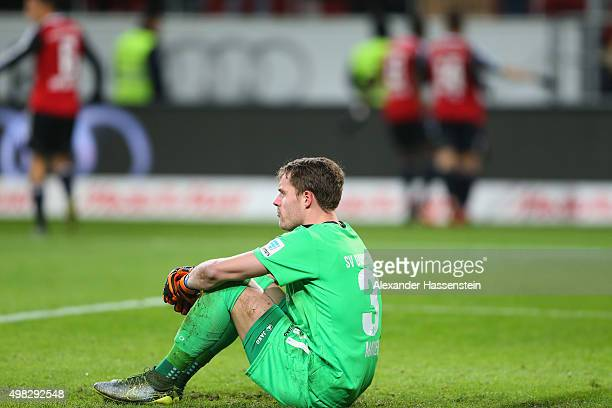 Christian Mathenia keeper of Darmstadt reacts whilst players of Ingolstadt celebrate the 3rd team goal during the Bundesliga match between FC...