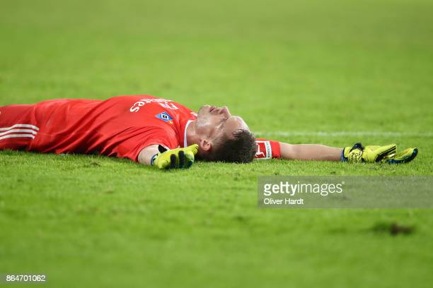 Christian Mathenia of Hamburg lies on the pitch during the Bundesliga match between Hamburger SV and FC Bayern Muenchen at Volksparkstadion on...