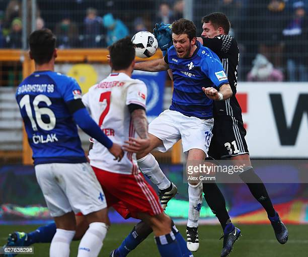 Christian Mathenia of Hamburg makes a save from Peter Niemeyer of Darmstadt during the Bundesliga match between SV Darmstadt 98 and Hamburger SV at...