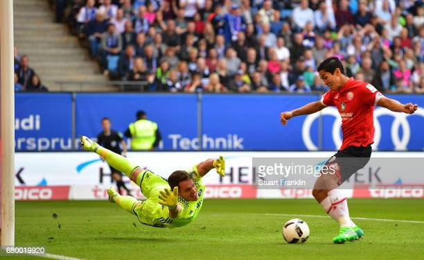 Christian Mathenia of Hamburg makes a save from Yoshinori Muto of Mainz during the Bundesliga match between Hamburger SV and 1 FSV Mainz 05 at...