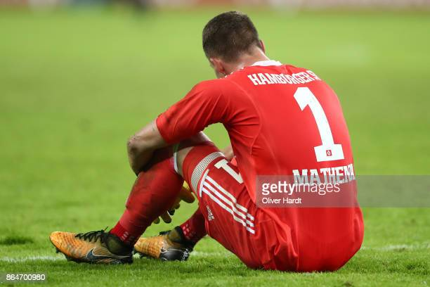 Christian Mathenia of Hamburg sits on the pitch during the Bundesliga match between Hamburger SV and FC Bayern Muenchen at Volksparkstadion on...