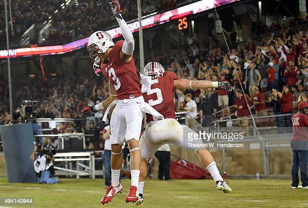 Christian McCaffrey and Michael Rector of the Stanford Cardinal's celebrates after McCaffrey scored a touchdown against the Washington Huskies in the...