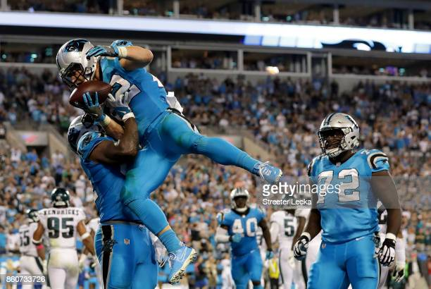 Christian McCaffrey celebrates with teammate Ed Dickson of the Carolina Panthers after a fourth quarter touchdown against the Philadelphia Eagles...