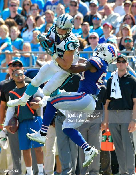 Christian McCaffrey of the Carolina Panthers makes a catch against Ramon Humber of the Buffalo Bills during their game at Bank of America Stadium on...