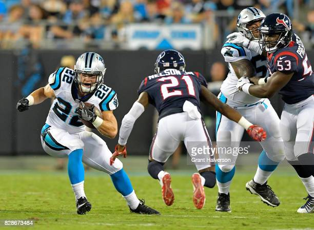 Christian McCaffrey of the Carolina Panthers runs against Marcus Gilchrist of the Houston Texans during the preseason game at Bank of America Stadium...