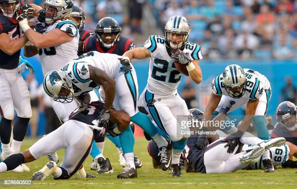 Christian McCaffrey of the Carolina Panthers runs against the Houston Texans during the preseason game at Bank of America Stadium on August 9 2017 in...