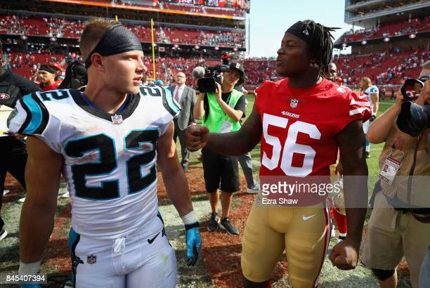 Christian McCaffrey of the Carolina Panthers talks to Reuben Foster of the San Francisco 49ers after their game at Levi's Stadium on September 10...