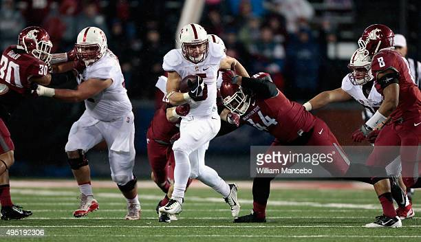 Christian McCaffrey of the Stanford Cardinal carries the ball against the Washington State Cougars in the first half at Martin Stadium on October 31...